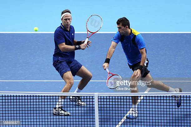 Robert Lindstedt of Sweden and Horia Tecau of Romania in action during the men's doubles match against Max Mirnyi of Belarus and Daniel Nestor of...