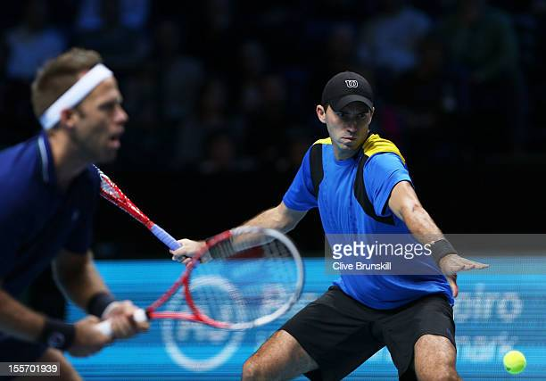 Robert Lindstedt of Sweden and Horia Tecau of Romania in action during the men's doubles match against Mahesh Bhupathi of India and Rohan Bopanna of...