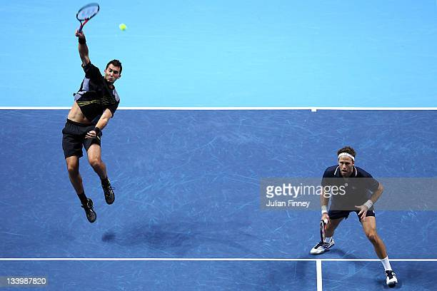 Robert Lindstedt of Sweden and Horia Tecau of Romania play during the men's doubles match against Bob Bryan of USA and Mike Bryan of USA during the...