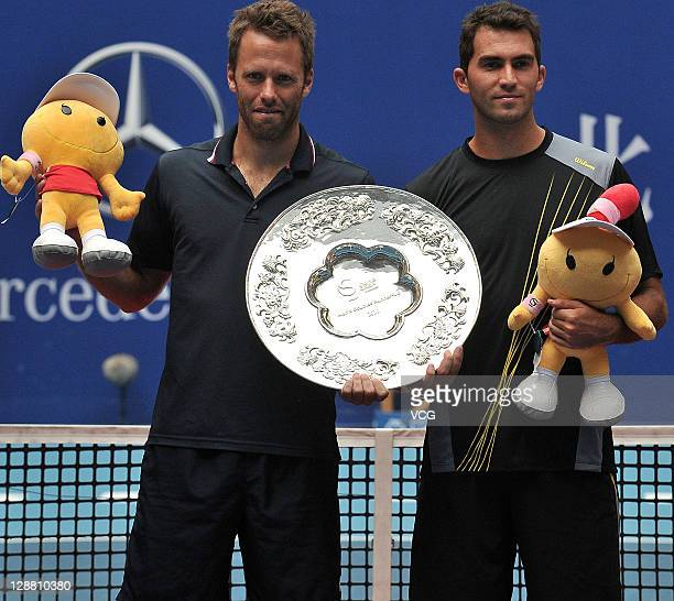 Robert Lindstedt of Sweden and Horia Tecau of Romania pose for photographers after being defeated by Nenad Zimonjic of Serbia and Michael Llodra of...