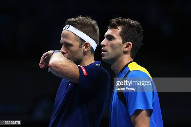 Robert Lindstedt of Sweden and Horia Tecau of Romania react after losing a point during the men's doubles match against Max Mirnyi of Belarus and...