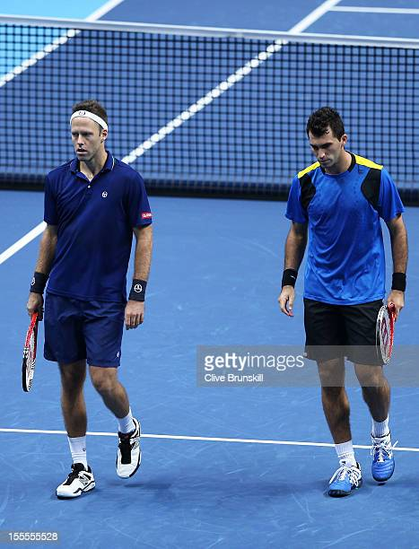 Robert Lindstedt of Sweden and Horia Tecau of Romania reacts after losing a point during the men's doubles match against Max Mirnyi of Belarus and...