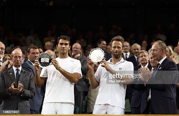 Robert Lindstedt of Sweden and Horia Tecau of Romania receive their runner-up trophies after losing their Gentleman's Doubles final match against...
