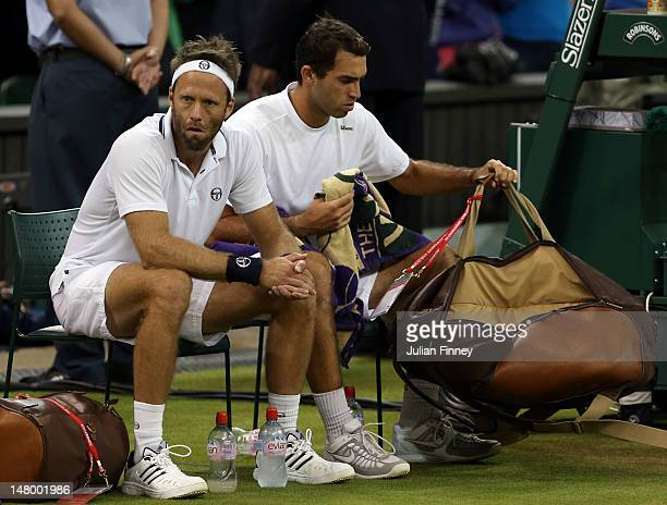 Robert Lindstedt of Sweden and Horia Tecau of Romania show their dejection after their Gentleman's Doubles final match against Jonathan Marray of...