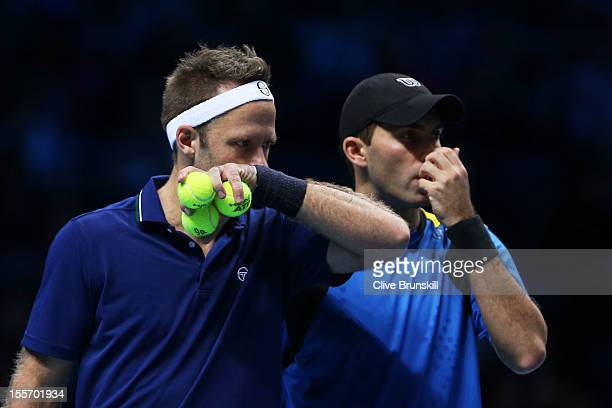 Robert Lindstedt of Sweden and Horia Tecau of Romania talk tactics during the men's doubles match against Mahesh Bhupathi of India and Rohan Bopanna...
