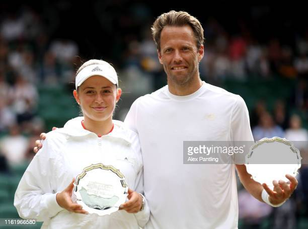 Robert Lindstedt of Sweden and Jelena Ostapenko of Latvia pose with the runners up trophy following their Mixed Doubles final against Ivan Dodig of...