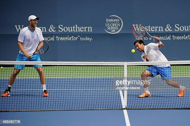 Robert Lindstedt of Sweden and Leander Paes of India participate in a doubles exhibition on day three of the Western & Southern Open on August 11,...