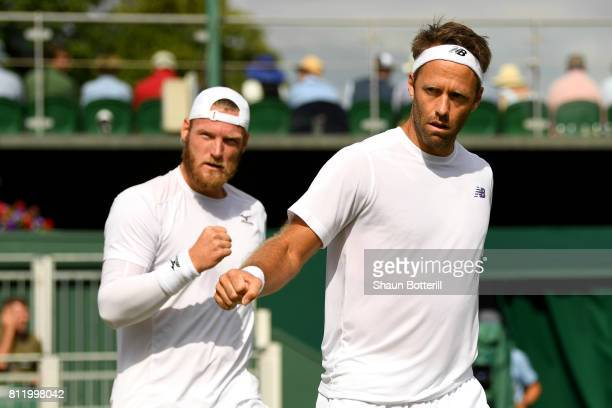 Robert Lindstedt of Sweden and Sam Groth of Australia celebrate during the Gentlemen's Doubles third round match against Nikola Mektic of Croatia and...