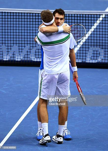 Robert Lindstedt of Sweden celebrates with Horia Tecau of Romania after their men's doubles match against Frederik Nielsen of Denmark and Jonathan...