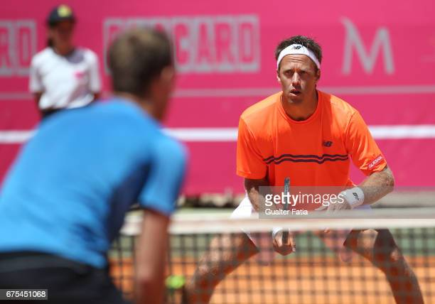 Robert Lindstedt of Sweden in action during his Millennium Estoril Open doubles match with Sam Groth of Australia against Ryan Harrison of the USA...