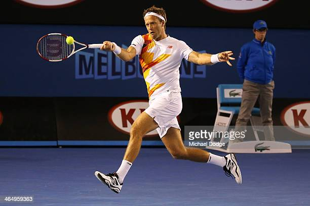 Robert Lindstedt of Sweden plays a forehand in his Men's Doubles Final with Lukasz Kubot of Poland against Eric Butorac of the United States and...