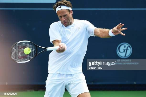 Robert Lindstedt of Sweden returns a forehand to Jonathan Erlich of Israel and Divij Sharan of India during the BBT Atlanta Open at Atlantic Station...