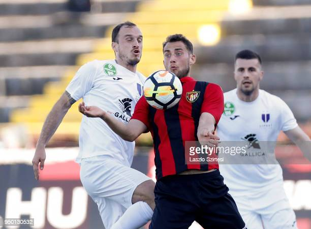 Robert Litauszki of Ujpest FC competes for the ball with Marton Eppel of Budapest Honved in front of Dzenan Burekovic of Ujpest FC during the...