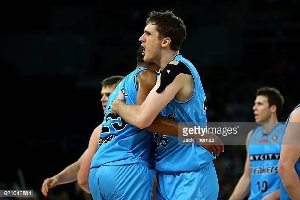 Robert Loe of the Breakers celebrates hitting a three pointer with team mate Akil Mitchell of the Breakers during the round five NBL match between...