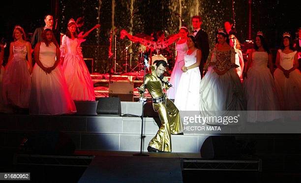 Robert Lopez aka El Vez performs with a group of quinceaneras fifteenyearold girls celebrating their coming to age parties at the California Plaza in...