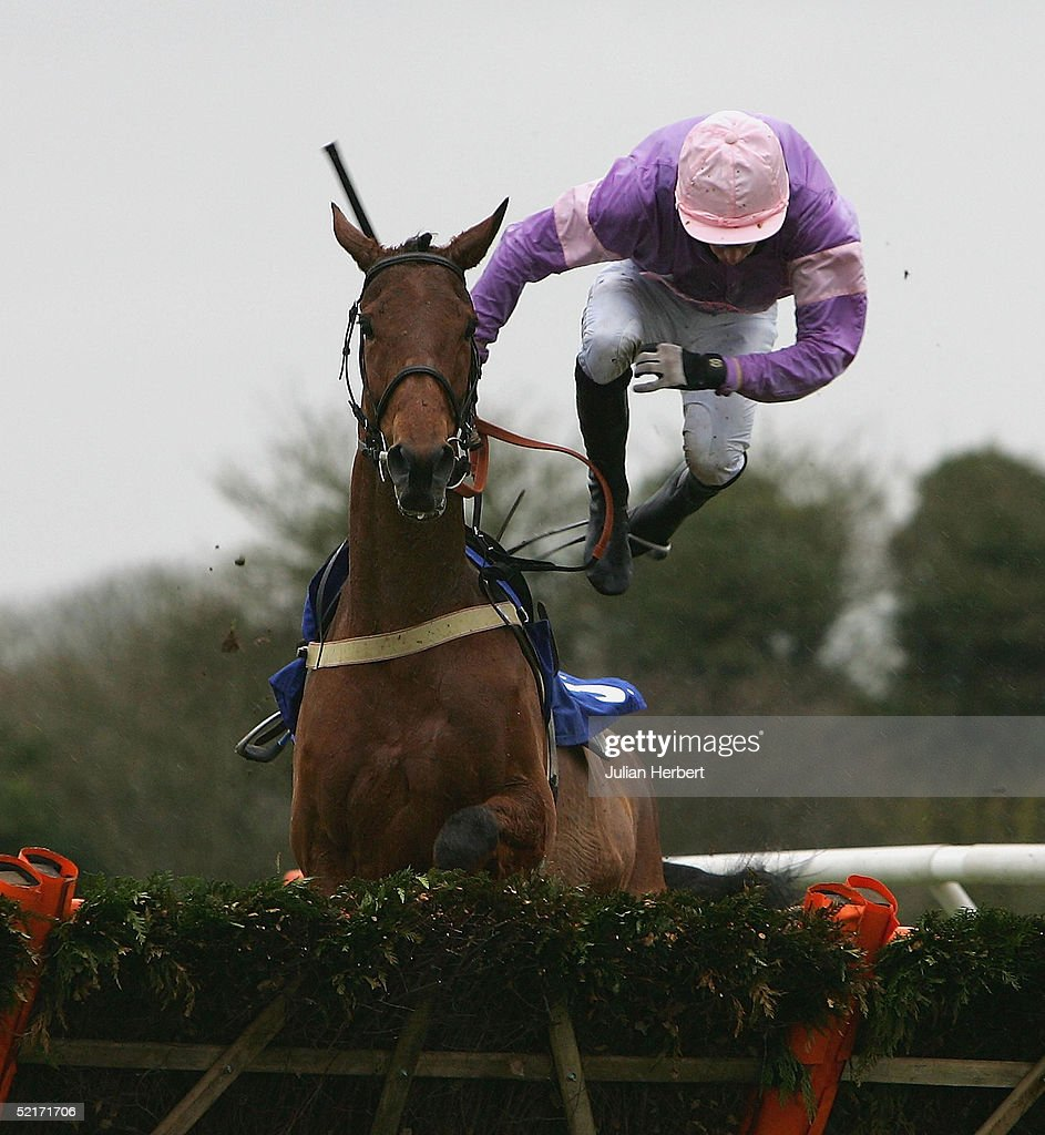 Robert Lucey - Butler parts company with Elle Roseador at the last flight during The coralpoker.com EBF Mares Only Hurdle Race run at Wincanton Racecourse on February 10, 2005 in Wincanton, England.