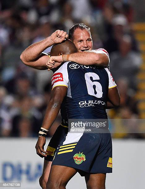 Robert Lui of the Cowboys celebrates his try with Matthew Scott during the round 26 NRL match between the North Queensland Cowboys and the Manly Sea...