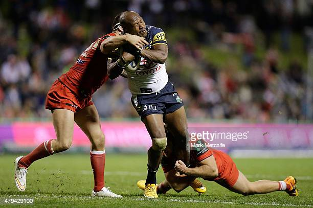 Robert Lui of the Cowboys is tackled during the round 17 NRL match between the St George Illawarra Dragons and the North Queensland Cowboys at WIN...