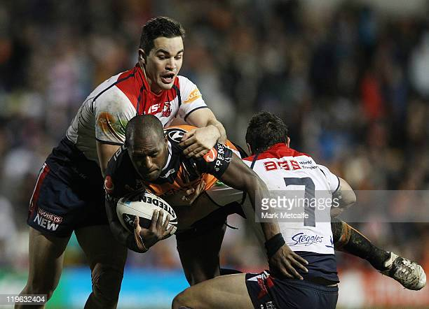 Robert Lui of the Tigers is tackled during the round 20 NRL match between the Wests Tigers and the Sydney Roosters at Leichhardt Oval on July 23 2011...