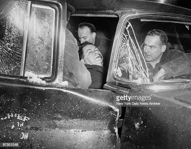 Robert Lynch chief of the 4th Battalion in his car after he collided with another car