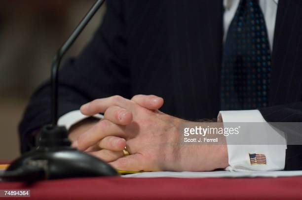 Robert M Gates President Bush's pick to become Defense secretary wears American flag cuff links as he testifies before the Senate Armed Services...