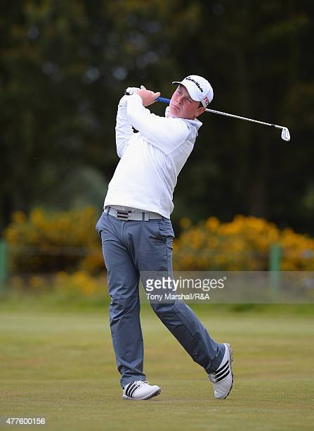 Robert MacIntyre of Glencruitten plays his first shot on the 13th tee during The Amateur Championship 2015 Day Four at Carnoustie Golf Club on June...