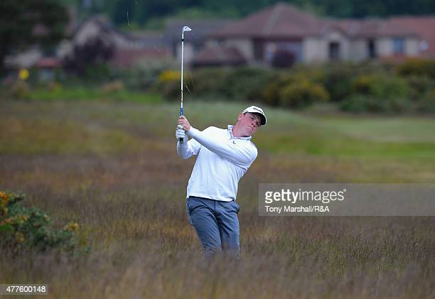 Robert MacIntyre of Glencruitten plays his second shot on the 12th fairway during The Amateur Championship 2015 Day Four at Carnoustie Golf Club on...