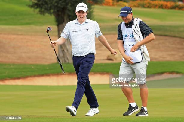 Robert MacIntyre of Scotland and his caddie react after a birdie on the second green during Day Four of the Aphrodite Hills Cyprus Showdown at...