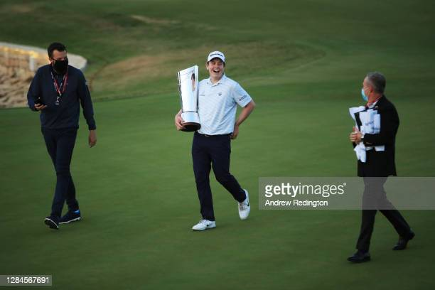 Robert MacIntyre of Scotland carries his trophy across the eighteenth green after winning the Aphrodite Hills Cyprus Showdown during Day Four of the...
