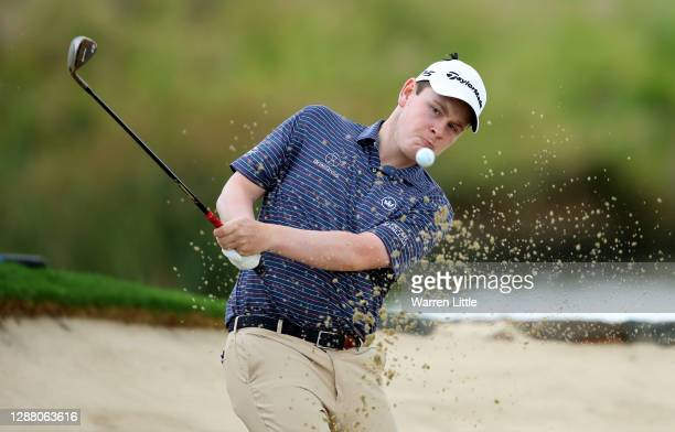 Robert Macintyre of Scotland plays a bunker shot on the 16th hole during the second round of the Alfred Dunhill Championship at Leopard Creek Country...