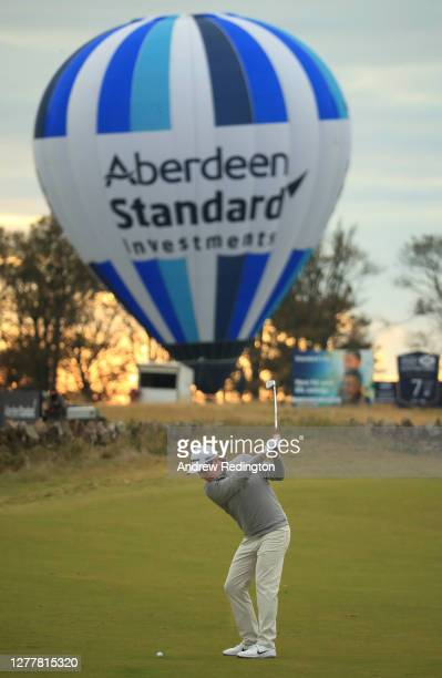 Robert MacIntyre of Scotland plays his second shot on the 18th hole during the first round of the Aberdeen Standard Investments Scottish Open at The...