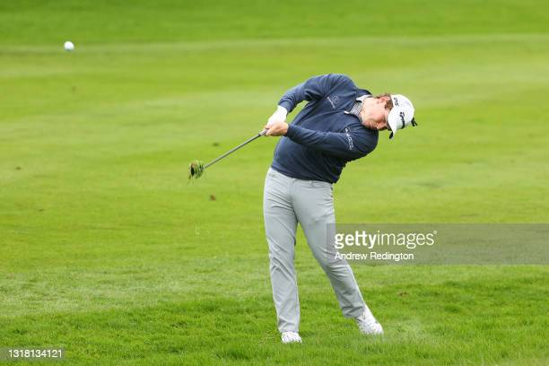 Robert MacIntyre of Scotland plays his second shot on the fifth hole during the Final Round of The Betfred British Masters hosted by Danny Willett at...