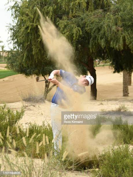 Robert Macintyre of Scotland plays his second shot on the par four 14th hole during the second round of the Omega Dubai Desert Classic at Emirates...