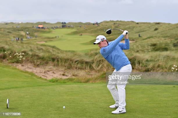 Robert MacIntyre of Scotland plays his shot from the seventh tee during the first round of the 148th Open Championship held on the Dunluce Links at...