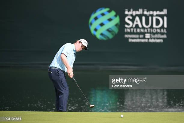 Robert Macintyre of Scotland putts on the 18th green during Day 2 of the Saudi International at Royal Greens Golf and Country Club on January 31,...