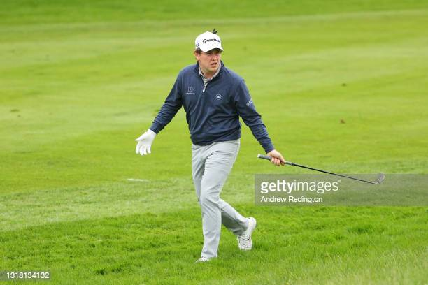 Robert MacIntyre of Scotland reacts after his second shot on the fifth hole during the Final Round of The Betfred British Masters hosted by Danny...