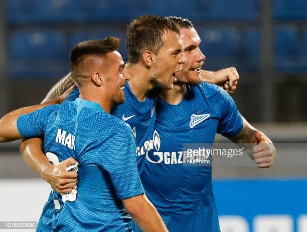 Robert Mak Artem Dzyuba and Anton Zabolotny of FC Zenit Saint Petersburg celebrate a goal during the UEFA Europa League third qualifying round second...