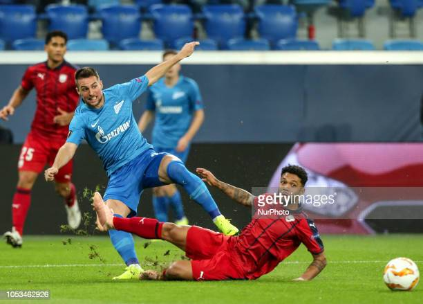 Robert Mak of FC Zenit Saint Petersburg and Otávio of FC Girondins de Bordeaux vie for the ball during the Group C match of the UEFA Europa League...