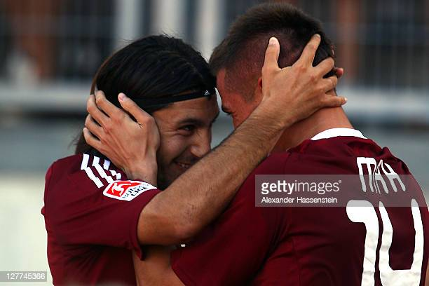 Robert Mak of Nuernberg celebrates scoring the second goal with his team mate Almog Cohen during the Bundesliga match between 1.FC Nuernberg and FSV...