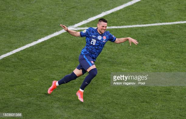 Robert Mak of Slovakia celebrates after scoring their side's first goal during the UEFA Euro 2020 Championship Group E match between Poland and...