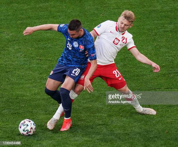 Robert Mak of Slovakia in action against Kamil Jozwiak of Poland during EURO 2020 Group E soccer match between Poland and Slovakia at Krestovsky...