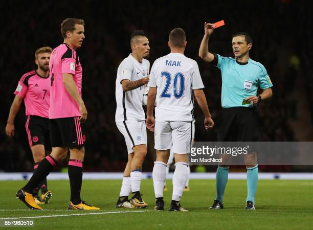 Robert Mak of Slovakia is shown a red card by referee Milorad Mazic and is sent off during the FIFA 2018 World Cup Group F Qualifier between Scotland...