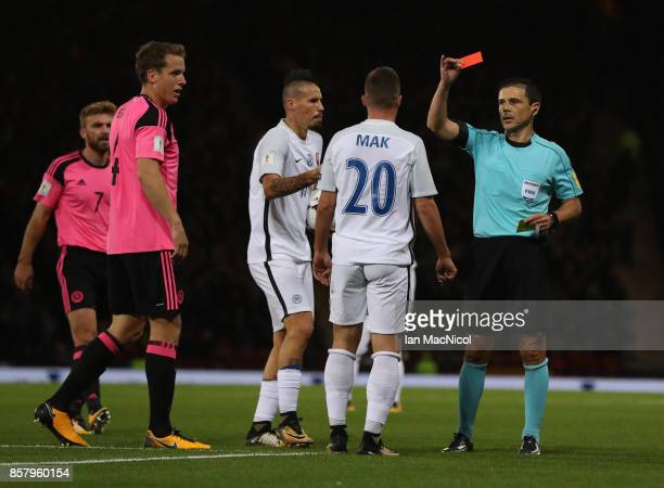 Robert Mak of Slovakia is shown a red card during the FIFA 2018 World Cup Qualifier between Scotland and Slovakia at Hampden Park on October 5, 2017...