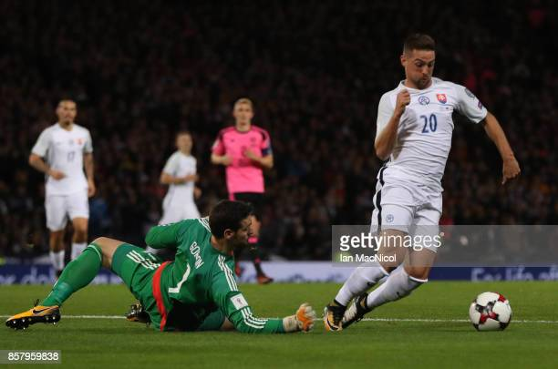 Robert Mak of Slovakia vies with Craig Gordon of Scotland resulting in a red card for Robert Mak during the FIFA 2018 World Cup Qualifier between...