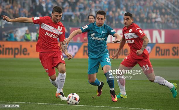 Robert Mak of Zenit StPetersburg in action against Salvatore Bocchetti and Mauricio of Spartak Moscow during Russian Footbal PremiereLeague football...