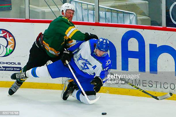 Robert Malloy of Australia fights for the puck with Daniel Spivak of Israel during the match between Australia and Israel as part of the 2016 IIHF...