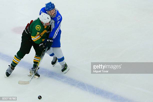 Robert Malloy of Australia fights for the puck with Elie Klein of Israel during the match between Australia and Israel as part of the 2016 IIHF Ice...