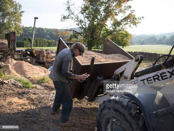 Robert Marble moves a container of sawdust on his converted dairy farm in Charlotte, Vermont, September 26, 2017. Marble is a firewood supplier who...