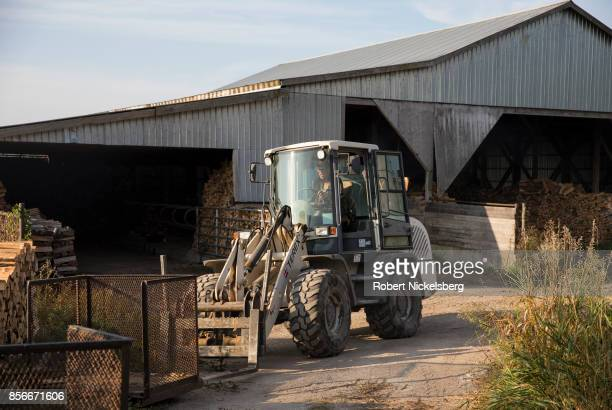 Robert Marble moves metal boxes to hold cut firewood on his converted dairy farm in Charlotte Vermont September 26 2017 Marble is a firewood supplier...