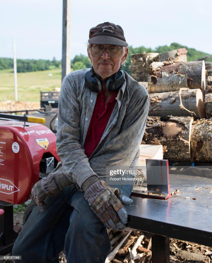 Robert Marble Cuts And Splits Firewood : News Photo